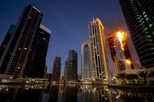 Flames engulf a portion of Tamweel residential tower at Jumeirah Lakes Towers,  in Dubai, United Arab Emirates, Sunday, Nov. 18, 2012. Civil defense officials did not give immediate details on possible casualties or the cause of the predawn fire.