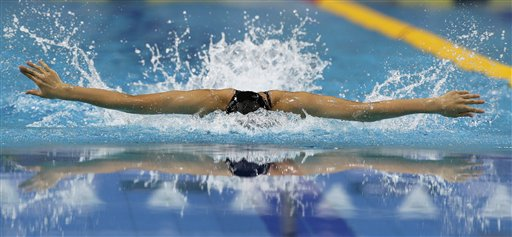 Hiroko Makino of Japan swims on her way to winning the gold medal during the Women's 400-meter Individual Medley final at the 9th Asian Swimming Championships, in Dubai on Thursday, Nov. 15, 2012.