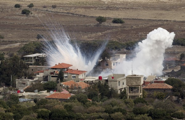 Smoke rises after shells fired by the Syrian army explode in the Syrian village of Bariqa, Monday, Nov. 12, 2012. The Israeli military says &quotSyrian mobile artillery&quot was hit after responding to stray mortar fire from its northern neighbor. The incident marked the second straight day that Israel has responded to fire from Syria that does not appear to be aimed at Israeli targets, nonetheless Israel has promised a tough response if the fire continues.