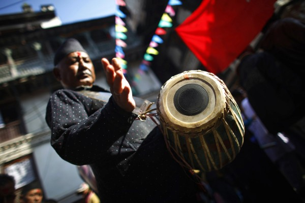 A Nepalese ethnic Newari beats a drum while participating in a parade to celebrate their New Year in Katmandu, Nepal, Wednesday, Nov 14, 2012. Members of the Newar community celebrated their New Year's Day by praying for longevity and performing rituals to purify and empower the soul for the coming year.