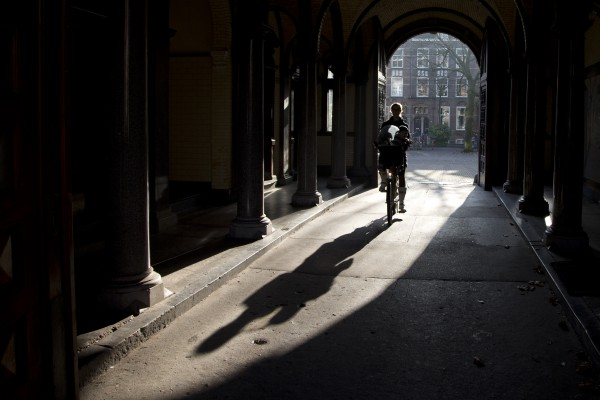 A cyclist rides through an arched underpass of one of the buildings of the former academic hospital Wilhelmina Gasthuis in Amsterdam, Netherlands, Monday Nov. 12, 2012. The hospital is no longer in use and only a few buildings, of which construction started in 1891, are left standing.