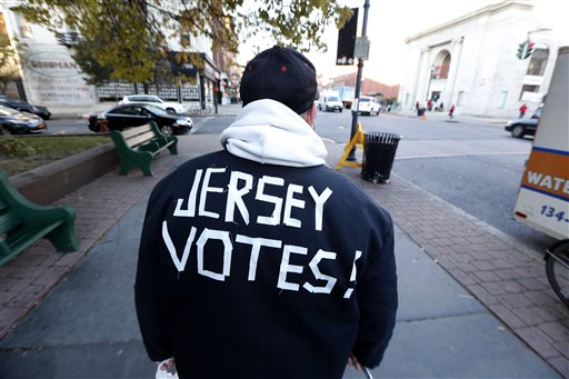Ed Lippman, 58, wears a message on his jacket on Election Day while walking home, Tuesday, Nov. 6, 2012, in Hoboken, N.J.