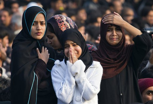 Pakistani Shiite Muslim girls mourn during a Muharram procession in Islamabad, Pakistan on Saturday, Nov. 24, 2012. Muharram is a month of mourning in remembrance of the martyrdom of Imam Hussein, the grandson of Prophet Mohammed.