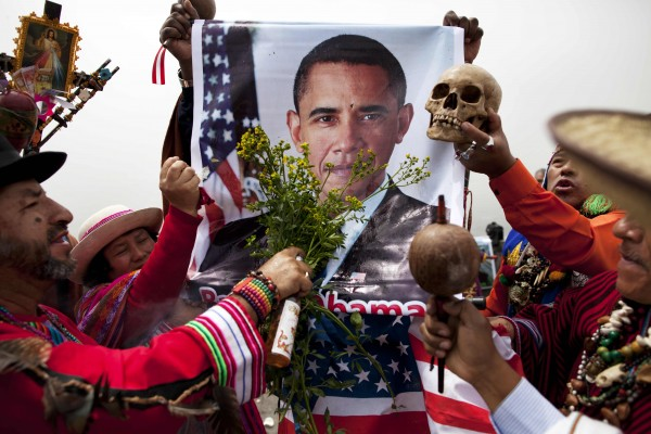 Peruvian shamans bless President Barack Obama using a poster of him during a ritual to predict the winner of the U.S. presidential election in Lima, Peru, Monday, Nov. 5, 2012. The shamans routinely predict outcomes for elections and sporting events, and on Monday predicted Obama will win.