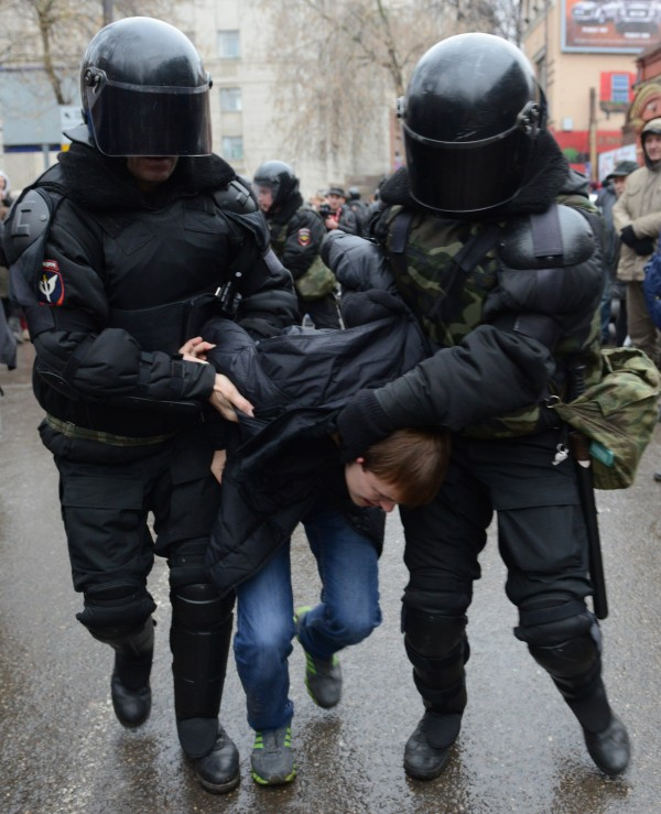 Riot policemen detain a participant of an opposition march in Nizhny Novgorod, about 200 miles east of Moscow, on Sunday, Nov. 4, 2012. The march took place on Unity Day, a national holiday established in 2005 to replace commemorations of the Bolshevik Revolution.