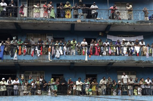 Residents of the Kissy neighborhood pack their balconies as they wait to see opposition candidate Julius Maada Bio, as his campaign convoy passes en route to his final rally in Freetown, Sierra Leone Thursday, Nov. 15, 2012. Ten years after the end of a devastating civil war, Sierra Leone will go to the polls on Saturday to choose between candidates including Bio and incumbent President Ernest Bai Koroma.