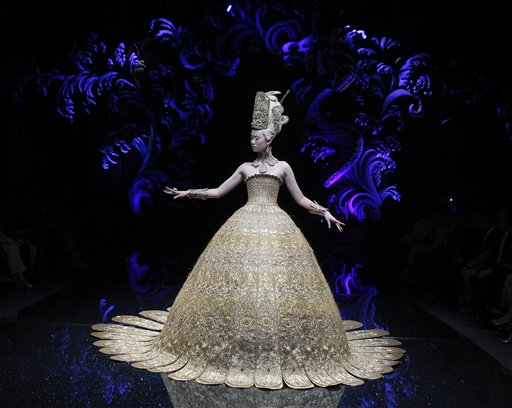 A model showcases a creation by Chinese designer Guo Pei on Tuesday Nov. 27, 2012,  in Singapore during the Asian Couture 2012 Singapore fashion show.