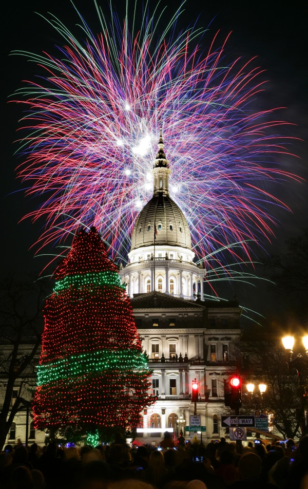 Fireworks explode over the state Capitol following a the ceremonial lighting of the official state Christmas tree, Friday, Nov. 16, 2012, in Lansing, Mich. The event was part of the 28th annual Silver Bells in the City celebration. This year's state tree is a 75-foot-tall Concolor Fir tree from Jackson, donated by Anthony and Stephanie LaPorte.