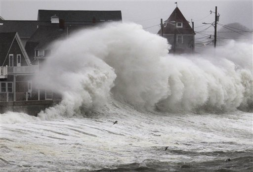 Waves crash into a seawall and buildings along the coast in Hull, Mass., on Wednesday, Nov. 7, 2012. A high-wind warning is in effect in the state until Wednesday night, with gusts of up to 60 mph expected in some coastal areas, and 50 mph gusts expected for Boston and western Massachusetts.