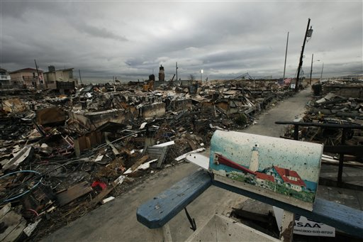 A mailbox with a lighthouse design sits on the porch of a burned out home in the Breezy Point section of Queens borough of New York,  Tuesday, Nov. 13, 2012. More than 50 homes were lost in a fire that swept through the oceanside community during superstorm Sandy.