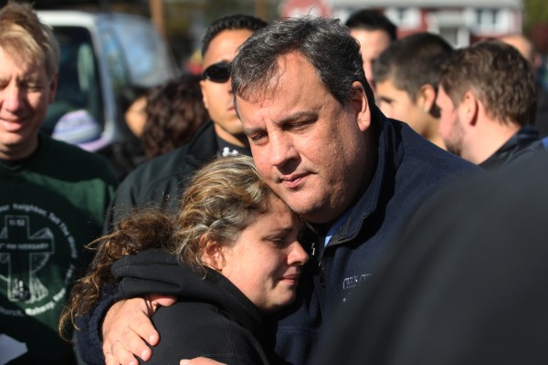 New Jersey Gov. Chris Christie comforts Kerri Berean, 33, a Chapman Street resident, Saturday, Nov. 3, 2012, in Little Ferry, N.J. Christie toured a section of Little Ferry that was flooded when Superstorm Sandy caused a tidal surge on the Hackensack River that overtook a natural berm protecting the town.