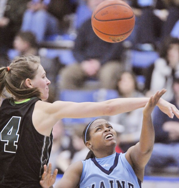 Maine's Ashleigh Roberts (1) gets fouled on her way to the basket by Binghamton's Viive Rebane during a game last January in Orono. Roberts, who scored 29 points in a Maine loss to Wofford Saturday, will lead the Black Bears in their home opener against Syracuse at 7 p.m. Tuesday.