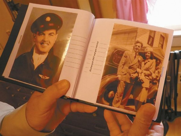 Joseph Bouchard holds photos from when he was 21 years old. He enlisted in the Army Air Force in 1944 at 18, and was discharged at 21 in 1947 as a staff sergeant.