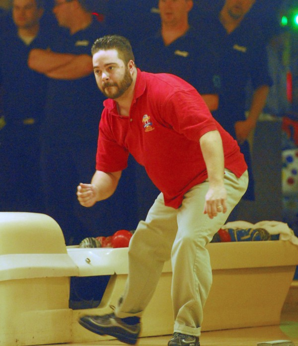 Brian Mayer of the USA East team watches pins fall during his turn to bowl at the championship round of World Team Candlepin Bowling Tourney against Fairlanes A+ of Nova Scotia at the Bangor-Brewer Bowling Lanes, Saturday, Nov. 10 2012.