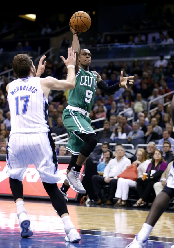 Boston Celtics guard Rajon Rondo (9) drives to the basket against Orlando Magic forward Josh McRoberts (17) during the second half of an NBA game, Sunday, Nov. 25, 2012, in Orlando, Fla.