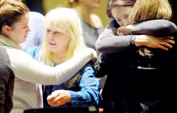 Deborah Fesmire, second from left, and Katrin Fesmire, second from right, react to the guilty verdict of Buddy Robinson in Androscoggin County Superior Court on Friday. Deborah Fesmire is the mother of Christiana Fesmire, the Lewiston woman killed by Buddy Robinson on July 1, 2011. Katrin Fesmire is Christiana's sister.