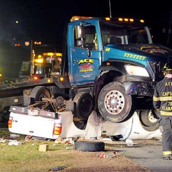 Auburn man hospitalized after rolling truck on interstate, police say