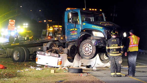 The driver of the pickup under the ACE Towing flat bed truck reportedly escaped serious injury when the two vehicles collided on Washington Street in Auburn early Tuesday evening. The drivers' names were not available, but a man who had been in the pickup truck was not hurt and was missing a shoe after the accident.