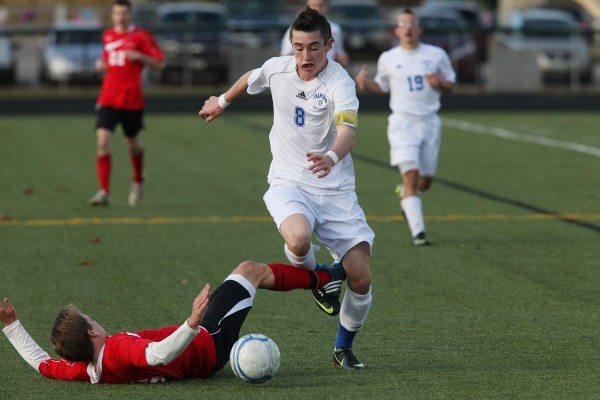 The Falmouth High School Yachtsmen John Cooper Lycan, tries to get past Camden Hills Windjammers' Jack Gallagher during the Maine Principals' Association Class B Boys Soccer State Championship Saturday, Nov. 3, at Scarborough High School in Scarborough, Maine,