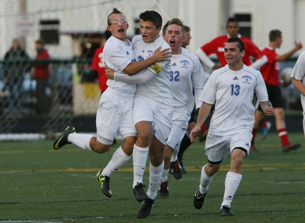 The Falmouth High School Yachtsmen, Luke Velas, left to right, Jack Pike, Thomas Wilberg, and William Mullin celebrate after a goal during the Maine Principals' Association Class B Boys Soccer State Championship Saturday, Nov. 3, at Scarborough High School in Scarborough, Maine.