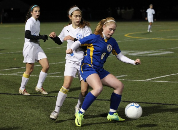 The Falmouth High School Yachtsmen's  Cassie Darrow, left, is fended off by Hermon High School Hawk's Jessica Allen,  Maine Principals' Association Class B Girls Soccer State Championship Saturday, Nov. 3, at Scarborough High School in Scarborough, Maine,