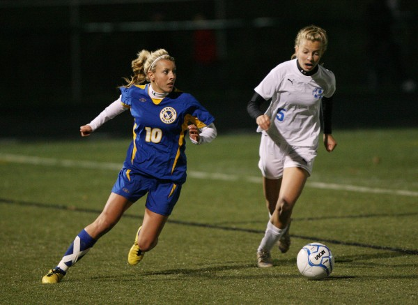 The Falmouth High School Yachtsmen's Georgia Babikian, right, and  Hermon High School Hawks' Gabrielle Bryant, left, race to the ball during Maine Principals' Association Class B Girls Soccer State Championship Saturday, Nov. 3, at Scarborough High School in Scarborough, Maine,