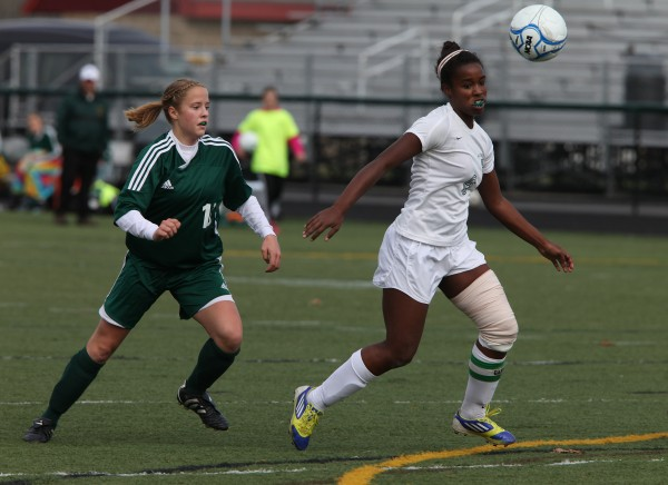 Fort Kent Warrior Jessica Morin, left, and Waynflete Flyer Rhiannan Jackson, right,  head for the ball during the Maine Principals' Association Class C Girls Soccer State Championship Saturday, Nov. 3, at Scarborough High School in Scarborough, Maine