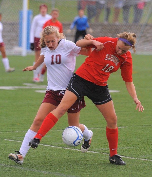 Bangor High School's Allison Boulier (left) battles for the ball with Scarborough High School's Hadlee Yescott during the first half of the Class A Championship game in Hampden Saturday afternoon.