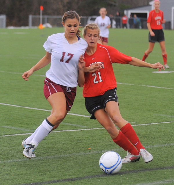Bangor High School's Jordan Seekins (left) battles for the ball with Scarborough High School's Katherine Kirk during the first half of the Class A Championship game in Hampden Saturday afternoon.