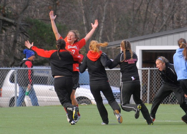 Scarborough High School's Sarah Martens celebrates with teammates after she scored winning goal against Bangor High School in the Class A Championship game in Hampden Saturday afternoon. Scarborough won the game 2-1 in double overtime.