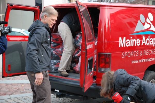 Maine Adaptive staff including Executive Director Peter Adams load the final jackets into the van for the trip to New York today.
