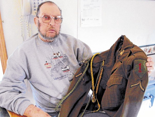 Retired Winter Harbor lobsterman Douglas Torrey holds the &quotIke&quot jacket that he was issued in 1946 as a member of the 1st Infantry Division.