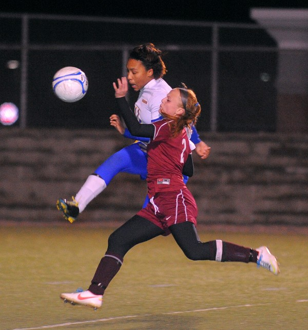 Washburn's Tyra Shaw (left) and Richmond's Noell Acord battle for the ball during the fist half of the Girls Class D Championship game in Hampden Saturday evening.  Richmond won the game 2-1 with penalty kicks.