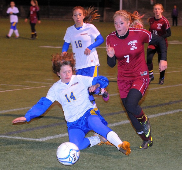 Washburn's Kennedy Churchill (left) and Richmond's Sadie Gosse battle for the ball during the second half of the Girls Class D Championship game in Hampden Saturday evening.  Richmond won the game 2-1 with penalty kicks.