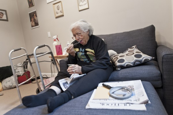 Viola Baez eats yogurt on July 21 in the MedCottage installed in her daughter's Alexandria, Va., backyard. The high-tech cottage is an option to a nursing home that some believe could change the face of elderly care.