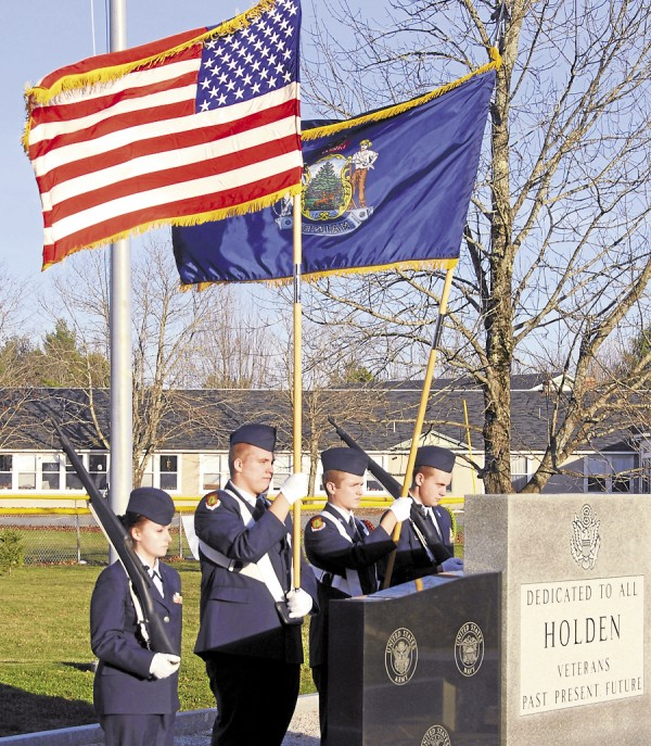 A color guard represented the Air Force Junior ROTC detachment at Brewer High School during a Veterans Day ceremony held Nov. 12, 2012 at the Holden Veterans Memorial. Members of the color guard were (from left) Cadet Capt. Sonya Tapley of Holden, Cadet Tech Sgt. Sam Burris of Brewer and Holden, Cadet Capt. Brandon Woods of Brewer, and Cadet Chief Master Sgt. Nate Nash of Eddington.