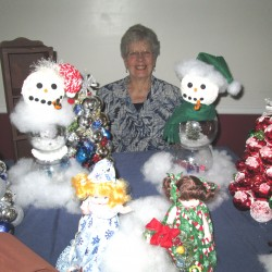 Rosalyn Mitchell, 80 years old, of Bangor, proudly displays items the adult day program participants have been busy creating for this year's craft sale.  Rosie has been attending the day program at Kindred Westgate for over 2 years.