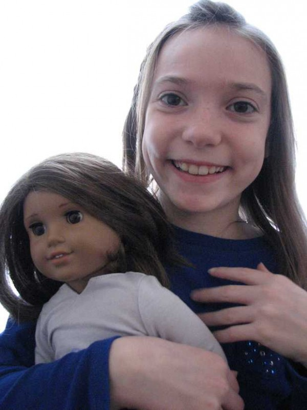 Kaylynn Johnson of Norway holds Lucy, her American Girl doll. Johnson is a finalist in the video story contest &quotCaroline's Share the Hero in You&quot by American Girl. She is collecting cereal boxes to be used in Haiti to make jewelry and other items so parents can help pay for food, shelter and education for their children.