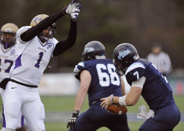 Maine quarterback Marcus Wasilewski (7)  is unable to avoid James Madison safety Titus Till (1) who got the sack  in the first half of an NCAA college football game in Orono, Maine, Saturday, Nov. 3, 2012.