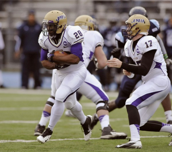 James Madison quarterback Michael Birdsong (17) hands off to tailback Jordan Anderson (28)  in the first half of an NCAA college football game in Orono, Maine, Saturday, Nov. 3, 2012.