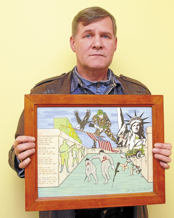 Jesse Wilson II, an Orono resident, displays a detailed color drawing that he made while stationed as a military policeman in West Berlin in the 1980s. Among his duties were assignments at the infamous Checkpoint Charlie separating East Berlin and West Berlin.