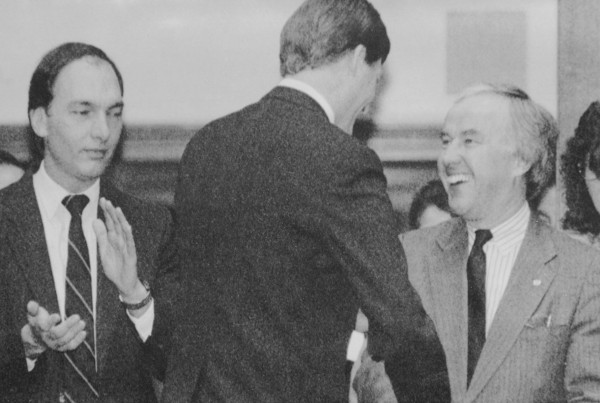Then-Gov. John McKernan (center) shakes hands with then House Speaker John L. Martin, D-Eagle Lake, after Maine lawmakers were sworn in by the Governor in Augusta in 1992. Martin later beat back a challenge to his position as as House Speaker by Rep. John Michael, D-Auburn, left.
