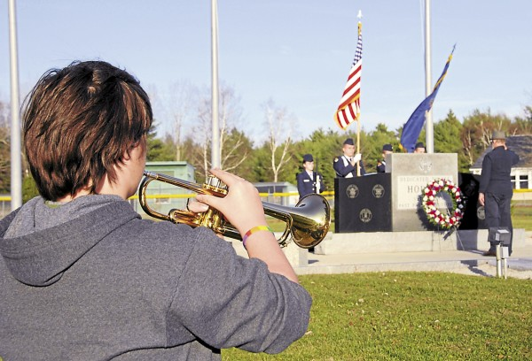 "Trumpeter Kristin Daigle of Brewer plays ""taps"" as veteran Roger Williams lays a wreath at the Holden Veterans Memorial on Nov. 12, 2012."