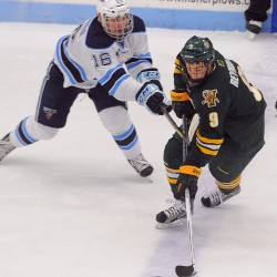 The University of Maine's Brice O'Connor (left) and Vermont's Kyle Reynolds battle for the puck during the second period of their game Friday evening in Orono