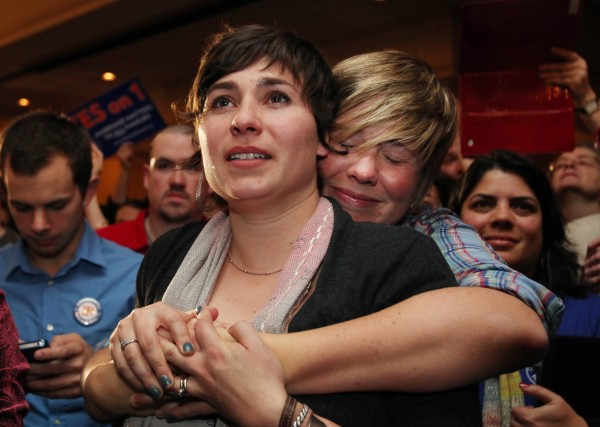 Lauren Snead, right, hugs her partner Katy Jayne, left, as they celebrate the legalization of same-sex marriage Tuesday Nov. 6, 2012  in Portland, Maine. Snead and Jayne plan to marry in the near future.