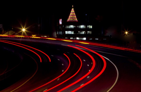 A Christmas tree made up of several strings of lights glows atop the B&M Baked Beans factory overlooking I-295 on Tuesday evening, Nov. 27, 2012, in Portland.