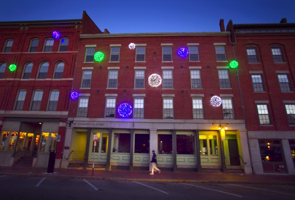 Holiday lights add festive color to the brick buildings on Commercial Street on Thursday, Nov. 29, 2012, in Portland.