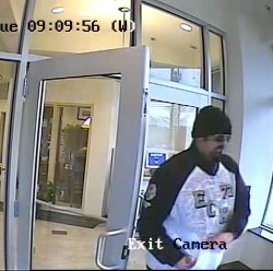 Portland police searching for bank robbery suspect wearing 'Maine Works' vest