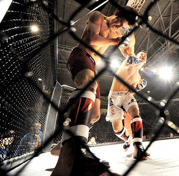 Shawn Goodrich, from Havoc MMA in Sanford, right, lands a right hook on Edward Miville, from Central Maine Brazilian Jiu-Jitsu in Auburn, during their amateur 145 pound bout during Fight Night V Saturday night in Lewiston.  Goodrich won the bout at 1:49 in the first round.