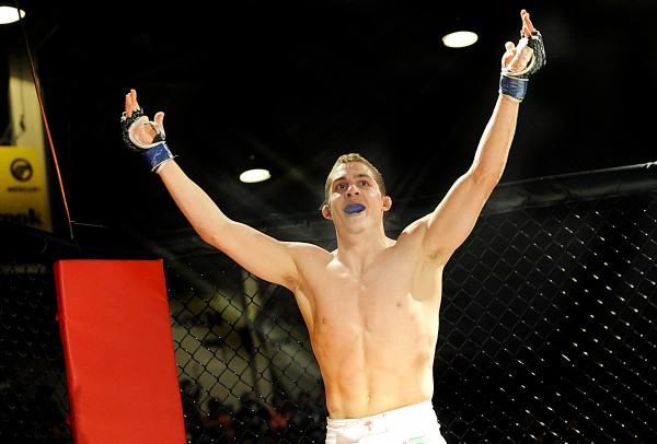Ray Wood, from Bangor, celebrates his first professional bout debut win over John Raio during Fight Night V at the Androscoggin Bank Colisee in Lewiston Saturday.  Wood won by TKO in 4:22 in the second round.